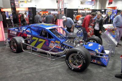 #77 Blue Aspalt or dirt race car on display