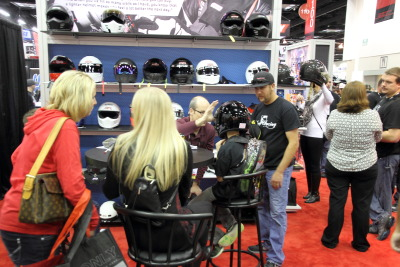 Child getting helmet fitted in Simpson booth