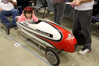 Granddaughter siting in Hi Winders Soap Box Derby