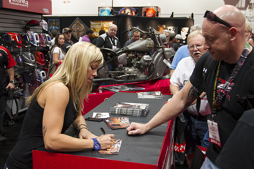 Jessi Combs signing autographs and conversing with her viewers in the Lincoln Electric booth at SEMA